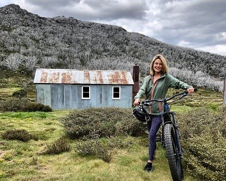 Sally Stanton mountain biking in the Snowy Mountains.